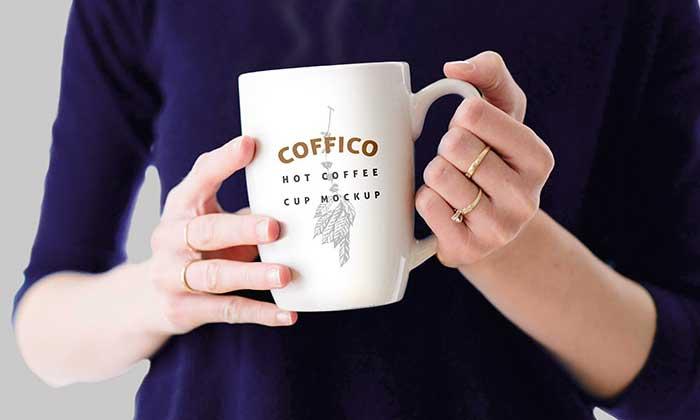 Woman-Holding-A-Coffee-Mug-Mockup-PSD.jpg1