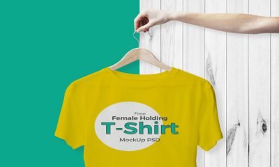 Free-Female-Holding-T-Shirt-Mockup-PSD.jpg10